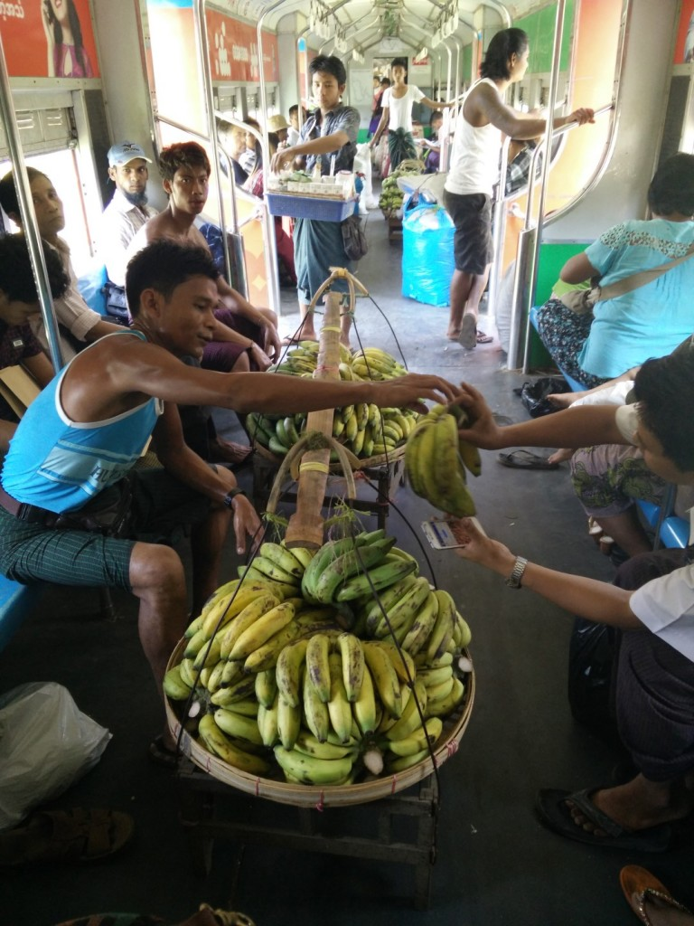 A man selling bananas on the train.