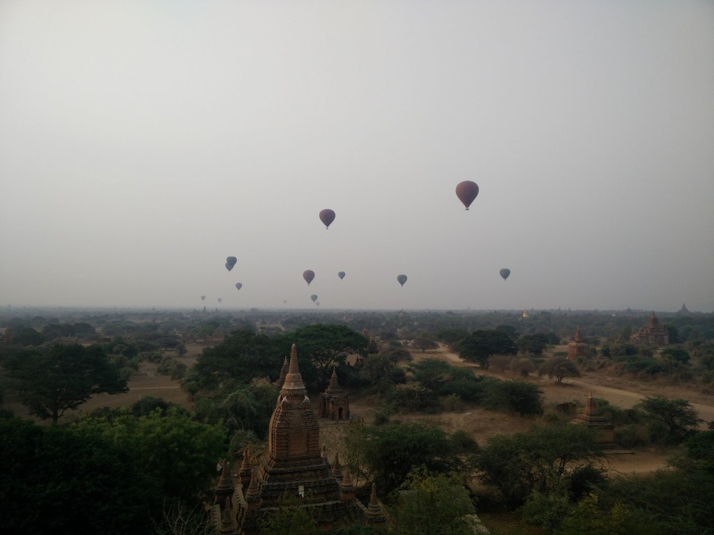 Bagan hot air balloons taking off at sunrise.