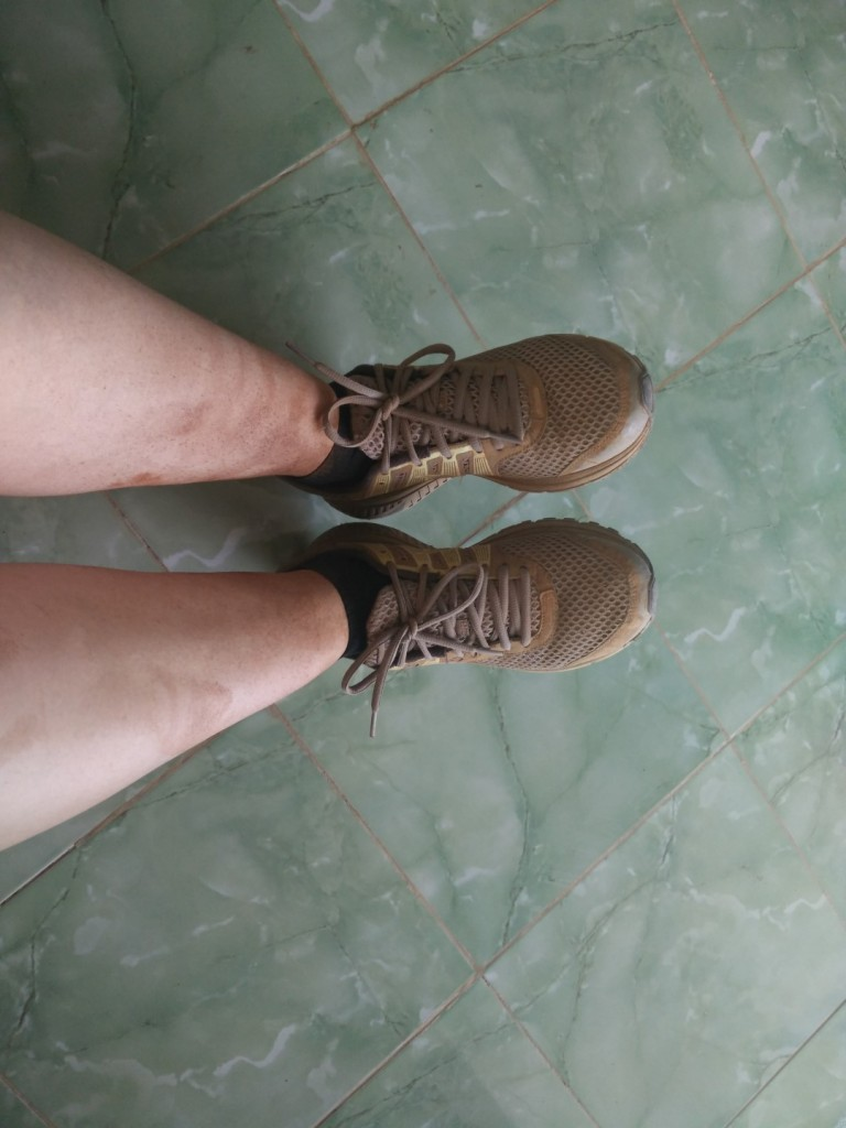 My legs covered in red dust after the trek - and it was even worse the day before :)