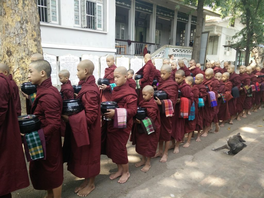 Young monks humbly waiting for their lunch.