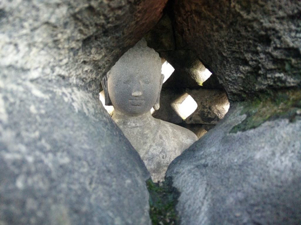 Inside one of the Borobudur's bells.