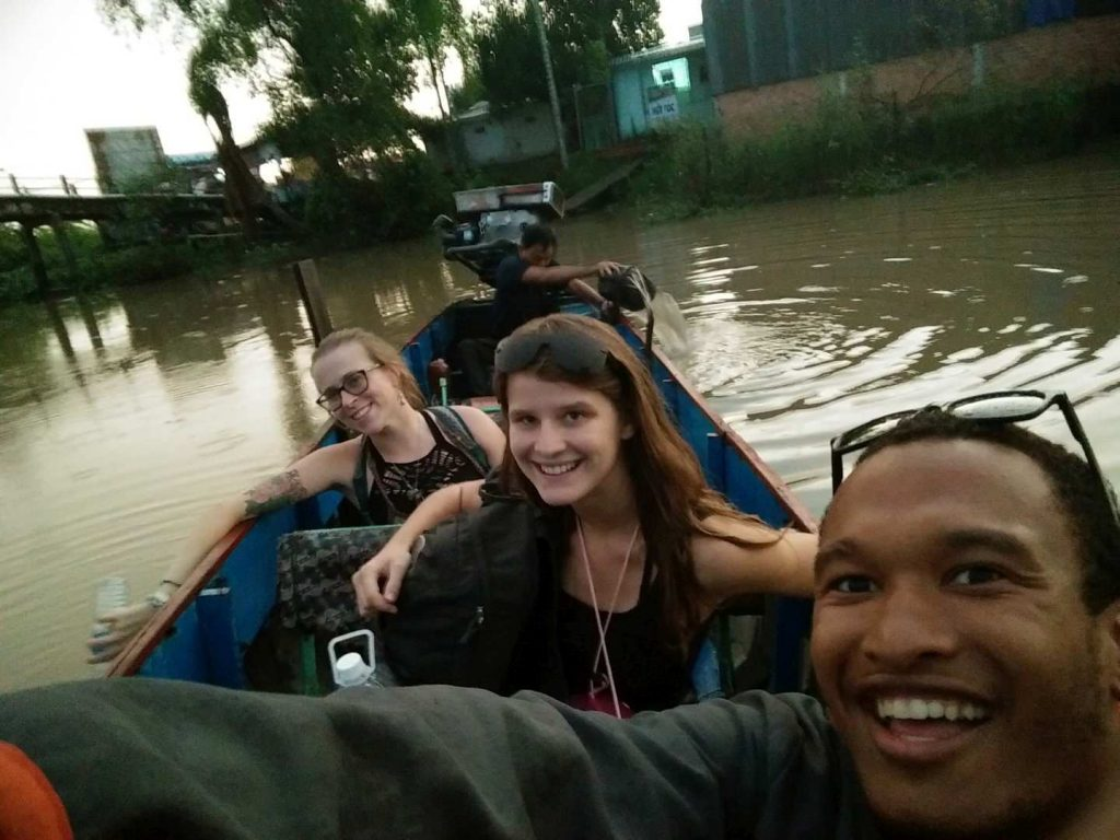 Selfie while our host was getting the water out of the boat and starting the engine.